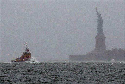 Waves crash over the bow of a tug boat as it passes near the Statue of Liberty in New York  Monday, Oct. 29, 2012 as rough water as the result of Hurricane Sandy churned the waters of New York Harbor. Hurricane Sandy continued on its path Monday, forcing the shutdown of mass transit, schools and financial markets, sending coastal residents fleeing, and threatening a dangerous mix of high winds and soaking rain.? &#40;AP Photo&#47;Craig Ruttle&#41; <span class=meta>(AP Photo&#47; Craig Ruttle)</span>