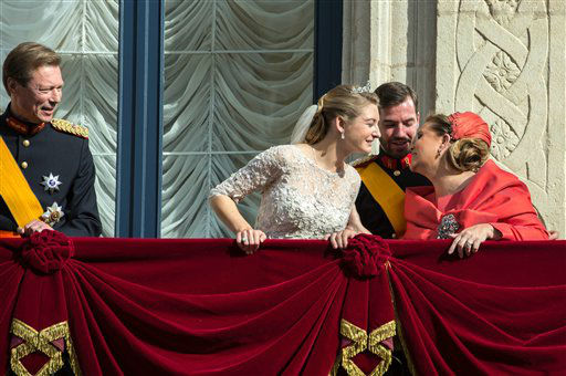 Luxembourg&#39;s Prince Guillaume and his father Grand Duke Henri, left, look on as Countess Stephanie and Grand Duchess Maria Teresa kiss on the balcony of the Royal Palace after their wedding in Luxembourg, Saturday, Oct. 20, 2012. &#40;AP Photo&#47;Geert vanden Wijngaert&#41; <span class=meta>(AP Photo)</span>