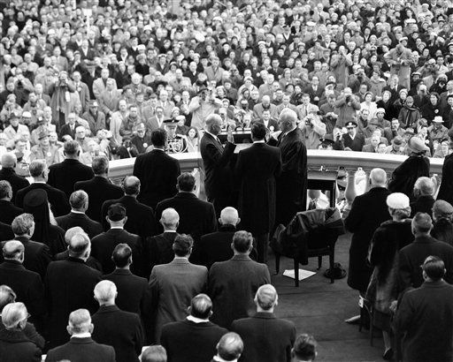 "<div class=""meta image-caption""><div class=""origin-logo origin-image ""><span></span></div><span class=""caption-text"">This is the view guests on the inaugural stand at the Capitol in Washington  Jan. 21, 1957 enjoyed as President Dwight Eisenhower was sworn in for a second term. Administering the oath, at right, is Chief Justice Earl Warren. In center, back to camera, is John Fey, clerk of the U.S. Supreme Court who is holding the bible for oath-taking. (AP Photo) (AP Photo/ Anonymous)</span></div>"