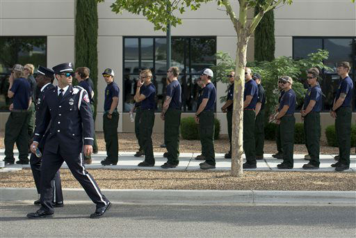 Firefighters from around the country line up outside Tim&#39;s Toyota Center, Tuesday, July 9, 2013 in Prescott, Ariz. to attend a memorial service honoring the 19 Granite Mountain Hotshot firefighters who were killed battling a blaze near Yarnell, Ariz. on June 30.  <span class=meta>(AP Photo&#47; Julie Jacobson)</span>