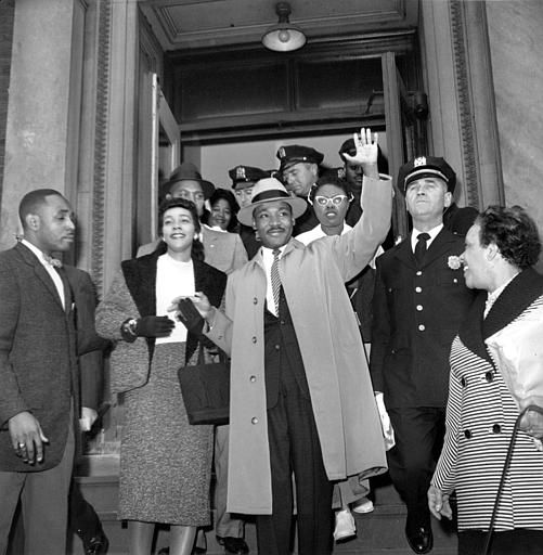 The Rev. Dr. Martin Luther King Jr., of Alabama, waves to the nearly 500 people waiting outside Harlem hospital in New York City on Oct. 3, 1958.  Dr. King was stabbed on Sept. 20.  &#40;AP Photo&#41; <span class=meta>(AP Photo&#47; XNBG)</span>