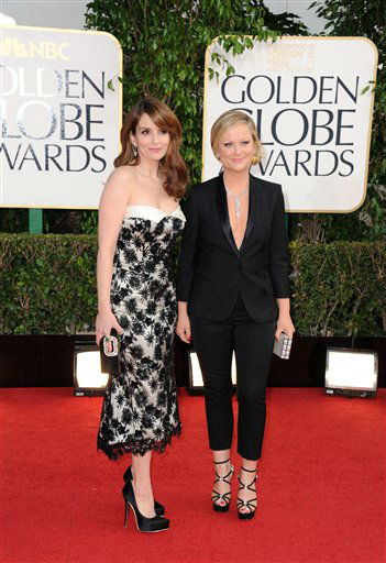 Show hosts Tina Fey, left, and Amy Poehler arrive at the 70th Annual Golden Globe Awards at the Beverly Hilton Hotel on Sunday Jan. 13, 2013, in Beverly Hills, Calif. <span class=meta>(Photo by Jordan Strauss&#47;AP)</span>