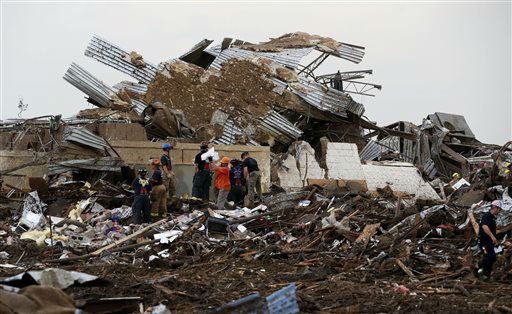 "<div class=""meta ""><span class=""caption-text "">Workers continue to dig through the rubble of Plaza Towers Elementary School after a tornado moved through Moore, Okla., Monday, May 20, 2013. (AP Photo Sue Ogrocki) (AP Photo/ Sue Ogrocki)</span></div>"
