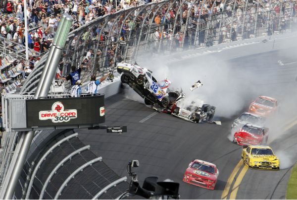 "<div class=""meta image-caption""><div class=""origin-logo origin-image ""><span></span></div><span class=""caption-text"">Kyle Larson's car (32) gets airborne during a multi-car wreck on the final lap of the NASCAR Nationwide Series auto race Saturday, Feb. 23, 2013, at Daytona International Speedway in Daytona Beach, Fla. Tony Stewart, in the red car at front, won the race. (AP Photo/David Graham) (AP Photo/ David Graham)</span></div>"