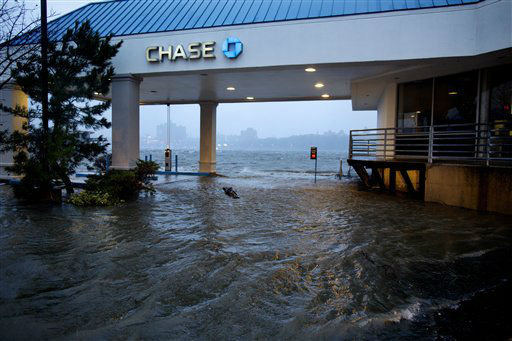 Rising water from the Hudson River overtakes a bank drive-through in Edgewater, N.J., Monday, Oct. 29, 2012 as Hurricane Sandy lashed the East Coast. The powerful storm made the westward lurch and took dead aim at New Jersey and Delaware on Monday, washing away part of the Atlantic City boardwalk, putting the presidential campaign on hold and threatening to cripple Wall Street and the New York subway system with an epic surge of seawater. &#40;AP Photo&#47;Craig Ruttle&#41; <span class=meta>(AP Photo&#47; Craig Ruttle)</span>