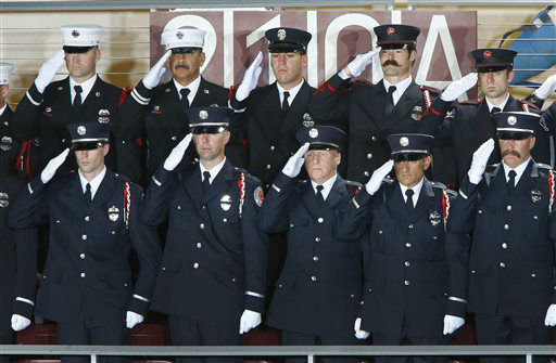 "<div class=""meta ""><span class=""caption-text "">Firefighters from Sacramento, Calif., stand during the National Anthem during a memorial service for the 19 fallen firefighters at Tim's Toyota Center in Prescott Valley, Ariz. on Tuesday, July 9, 2013.   Prescott's Granite Mountain Hotshots were overrun by smoke and fire while battling a blaze on a ridge in Yarnell, about 80 miles northwest of Phoenix on June 30, 2013.     (AP Photo/ David Kadlubowski)</span></div>"