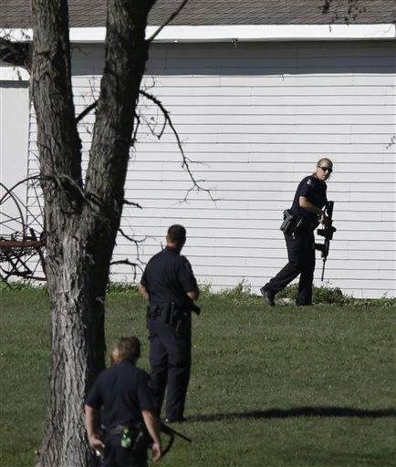 Police personnel search areas around the Sikh Temple of Wisconsin in Oak Creek, Wis., after a shooting Sunday, Aug 5, 2012. A gunman killed six people at the suburban Milwaukee temple in a rampage that left terrified congregants hiding in closets and others texting friends outside for help. The suspect was killed outside the temple in a shootout with police officers.   <span class=meta>(AP Photo&#47; Jeffrey Phelps)</span>