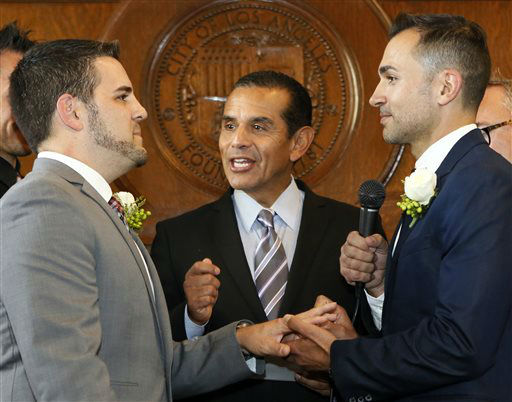 Jeff Zarrillo, left, and Paul Katami are married by Los Angeles Mayor Antonio Villaraigosa, center, Friday June 28, 2013 at City Hall in Los Angeles. A three-judge panel of the 9th U.S. Circuit Court of Appeals issued a brief order Friday afternoon dissolving, &#34;effective immediately,&#34; a stay it imposed on gay marriages while the lawsuit challenging the ban advanced through the court.   <span class=meta>(AP Photo&#47; Damian Dovarganes)</span>