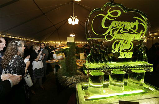 "<div class=""meta ""><span class=""caption-text "">Guests enjoy food next to an ice sculpture that reads ""Governor's Inaugural Ball 2013,"" Wednesday, Jan. 16, 2013 at the Capitol in Olympia, Wash. to celebrate the inauguration of Washington Gov. Jay Inslee.   (AP Photo/ Ted S. Warren)</span></div>"