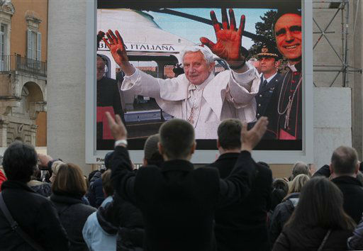 Faithful watch a giant screen showing Pope Benedict XVI  in St. Peter&#39;s Square, at the Vatican,Thursday, Feb. 28, 2013. The 85-year-old German Pope Benedict is stepping down on Thursday evening, the first pope to do so in 600 years, after saying he no longer has the mental or physical strength to vigorously lead the world&#39;s 1.2 billion Catholics.   <span class=meta>(AP Photo&#47; Dmitry Lovetsky)</span>