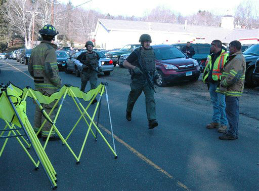 In this photo provided by the Newtown Bee, police officers are on the scene outside Sandy Hook Elementary School in Newtown, Conn., where authorities say a gunman opened fire, killing 26 people, including 20 children, Friday, Dec. 14, 2012. &#40;AP Photo&#47;Newtown Bee, Shannon Hicks&#41;   <span class=meta>(AP Photo&#47; Shannon Hicks)</span>