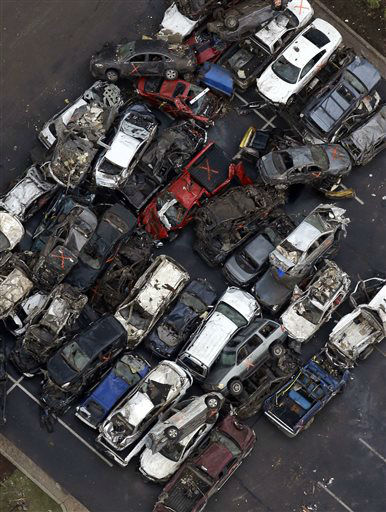 "<div class=""meta ""><span class=""caption-text "">Damaged vehicles from Monday's tornado can be seen in the parking lot of the Moore Medical Center Tuesday, May 21, 2013, in Moore, Oklahoma. A huge tornado roared through the Oklahoma City suburb Monday, flattening an entire neighborhoods and destroying an elementary school with a direct blow as children and teachers huddled against winds.   (AP Photo/ Tony Gutierrez)</span></div>"