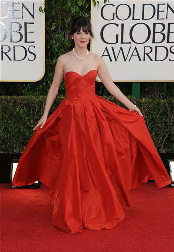 "<div class=""meta ""><span class=""caption-text "">Zooey Deschanel arrives at the 70th Annual Golden Globe Awards at the Beverly Hilton Hotel on Sunday Jan. 13, 2013, in Beverly Hills, Calif. (Photo by Jordan Strauss/AP)</span></div>"