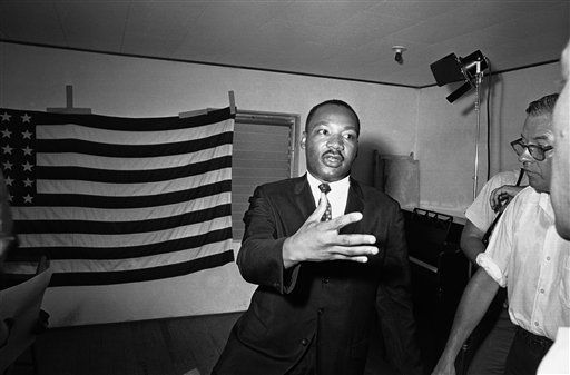 "<div class=""meta ""><span class=""caption-text "">Dr. Martin Luther King Jr. in St. Augustine, Florida on July 1, 1964, announced plans for a south wide campaign to implement provisions of the civil rights bill when it is signed into law expectable on July 4. The first week or so after the signing will be devoted to trying to talk merchants into serving African Americans, then simultaneous tests of compliance will be made throughout the South. (AP Photo) (AP Photo/ Anonymous)</span></div>"