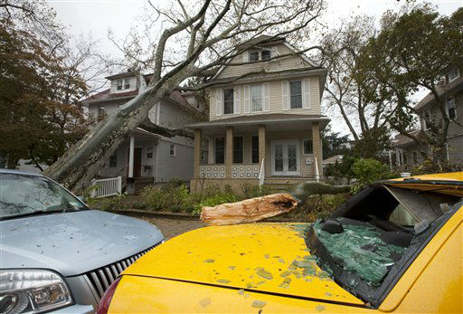 "<div class=""meta ""><span class=""caption-text "">A tree leans against a house Tuesday, Oct. 30, 2012, in the Bay Ridge neighborhood in the Brooklyn borough of New York, while another tree lies on a taxi with a shattered rear window in the aftermath of superstorm Sandy. New York City awakened Tuesday to a flooded subway system, shuttered financial markets and hundreds of thousands of people without power a day after a wall of seawater and high winds slammed into the city, destroying buildings and flooding tunnels.   (AP Photo/David Boe) (AP Photo/ David Boe)</span></div>"