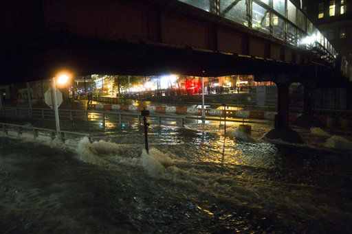"<div class=""meta ""><span class=""caption-text "">Sea water floods the entrance to the Brooklyn Battery Tunnel, Monday, Oct. 29, 2012, in New York. Sandy continued on its path Monday, as the storm forced the shutdown of mass transit, schools and financial markets, sending coastal residents fleeing, and threatening a dangerous mix of high winds and soaking rain.? (AP Photo/ John Minchillo) (AP Photo/ John Minchillo)</span></div>"