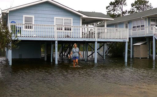 Gina Johnson wades through her front yard in Gulf Shores, Ala., on Wednesday, Aug. 29, 2012, after the coastal town took a glancing blow from Hurricane Isaac as it made landfall in Louisiana. While the storm brought heavy rain and wind to the Alabama coast, little significant damage was reported.   <span class=meta>(AP Photo&#47; Jay Reeves)</span>