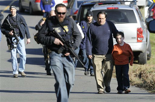 Parents leave a staging area after being reunited with their children following a shooting at the Sandy Hook Elementary School in Newtown, Conn., about 60 miles &#40;96 kilometers&#41; northeast of New York City, Friday, Dec. 14, 2012. An official with knowledge of Friday&#39;s shooting said 27 people were dead, including 18 children. It was the worst school shooting in the country&#39;s history.   <span class=meta>(AP Photo&#47; Jessica Hill)</span>