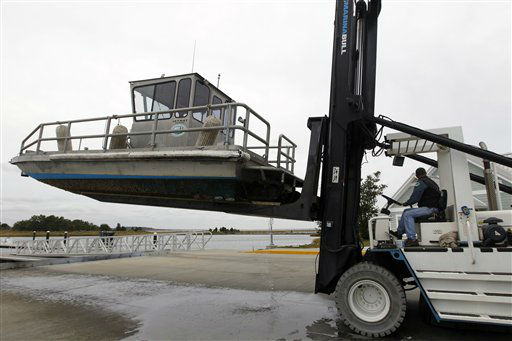 A marina worker uses a forklift to move a boat at the Indian River Marina in Delaware, Md. on Saturday, Oct. 27, 2012 as Hurricane Sandy approaches the Atlantic coast. &#40; AP Photo&#47;Jose Luis Magana&#41; <span class=meta>(AP Photo&#47; Jose Luis Magana)</span>
