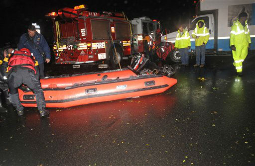 An FDNY inflatable is prepared for launch along 14th street east of Avenue B where water has trapped people in the wake of Hurricane Sandy, Monday, Oct. 29, 2012, in New York.  Sandy continued on its path Monday, as the storm forced the shutdown of mass transit, schools and financial markets, sending coastal residents fleeing, and threatening a dangerous mix of high winds and soaking rain.?  <span class=meta>(AP Photo&#47; Louis Lanzano)</span>