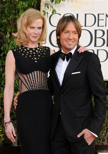"<div class=""meta ""><span class=""caption-text "">Musician Keith Urban and actress Nicole Kidman arrive at the 70th Annual Golden Globe Awards at the Beverly Hilton Hotel on Sunday Jan. 13, 2013, in Beverly Hills, Calif.  (Photo by Jordan Strauss/AP)</span></div>"