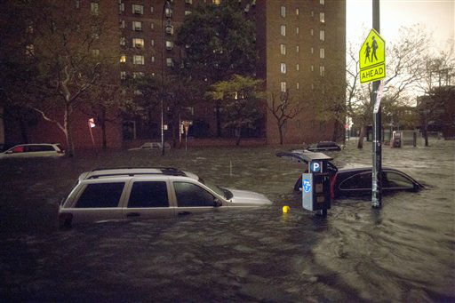 Vehicles are submerged on 14th Street near the Consolidated Edison power plant, Monday, Oct. 29, 2012, in New York. Sandy continued on its path Monday, as the storm forced the shutdown of mass transit, schools and financial markets, sending coastal residents fleeing, and threatening a dangerous mix of high winds and soaking rain.? &#40;AP Photo&#47; John Minchillo&#41; <span class=meta>(AP Photo&#47; John Minchillo)</span>