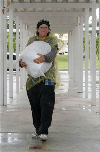 Cheri Senecal walks with a bag of personal items to a shelter in Key West, Fla., Saturday, Aug. 25, 2012 as she prepares for Tropical Storm Isaac, Saturday, Aug. 25, 2012. Isaac&#39;s winds are expected to be felt in the Florida Keys by sunrise Sunday morning.  <span class=meta>(AP Photo&#47; Alan Diaz)</span>