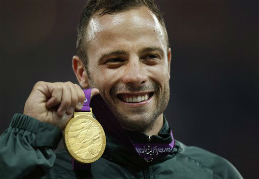 FILE - In this Saturday, Sept. 8, 2012, file photo, Gold medalist South Africa&#39;s Oscar Pistorius poses with his medal during the ceremony after winning the men&#39;s 400 meters T44 category final during the athletics competition at the 2012 Paralympics, in London. Olympic sprinter Oscar Pistorius has been arrested after a 30-year-old woman was shot dead at his home in South Africa. Police say Pistorius, a double-amputee known as &#34;Blade Runner,&#34; was taken into custody after the shooting early Thursday,  Feb. 14, 2013,  at his home in a gated complex in the country&#39;s capital.    <span class=meta>(AP Photo&#47; Matt Dunham)</span>