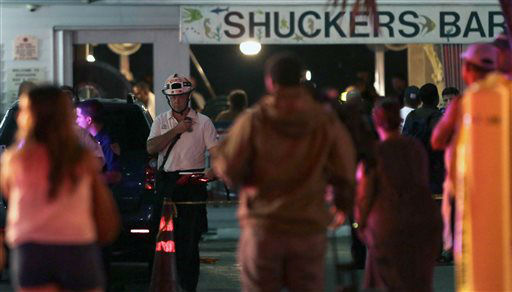 Miami-Dade Fire Rescue workers are shown in front of the Shuckers Bar and Restaurant, a packed outdoor deck collapsed at the popular Miami-area sports bar, Thursday June 13, 2013. The packed outdoor deck behind the popular Miami-area sports bar partially collapsed during the NBA Finals on Thursday night, sending dozens of patrons into the shallow waters of Biscayne Bay.  <span class=meta>(AP Photo&#47; Alan Diaz)</span>