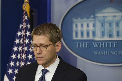 Press Secretary Jay Carney listens to a follow up question regarding the school shooting in Newtown, Conn., after he told reporters that President Barack Obama is receiving updates on the situation during the daily press briefing at the White House in Washington, Friday, Dec. 14, 2012.   <span class=meta>(AP Photo&#47; Charles Dharapak)</span>