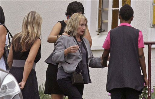 June Steenkamp, center, the mother of Reeva Steenkamp, arrives for her funeral in Port Elizabeth, South Africa, Tuesday, Feb. 19, 2013. Olympic athlete Oscar Pistorius is charged with the premeditated murder of Reeva Steenkamp on Valentine&#39;s Day. The defense lawyer says it was an accidental shooting.   <span class=meta>(AP Photo&#47; Schalk van Zuydam)</span>