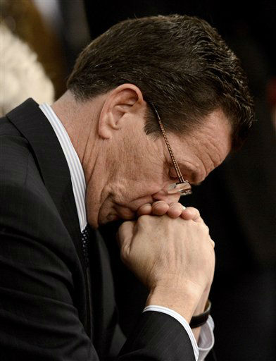 "<div class=""meta ""><span class=""caption-text "">Connecticut Gov. Dannel Malloy bows his head during a moment of silence during a vigil service for victims of the Sandy Hook Elementary School shooting, at the St. Rose of Lima Roman Catholic Church in Newtown, Conn. Friday, Dec. 14, 2012. (AP Photo/Andrew Gombert, Pool)</span></div>"