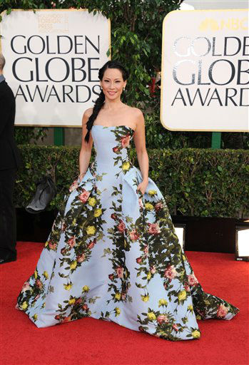 "<div class=""meta ""><span class=""caption-text "">Lucy Liu arrives at the 70th Annual Golden Globe Awards at the Beverly Hilton Hotel on Sunday Jan. 13, 2013, in Beverly Hills, Calif.  (Photo by Jordan Strauss/AP)</span></div>"