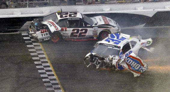 Brad Keselowski &#40;22&#41; and Kyle Larson &#40;32&#41; slide across the finish line after they were involved in a mulit-car crash on the final lap of the NASCAR Nationwide Series auto race at Daytona International Speedway, Saturday, Feb. 23, 2013, in Daytona Beach, Fla. &#40;AP Photo&#47;John Raoux&#41; <span class=meta>(AP Photo&#47; John Raoux)</span>