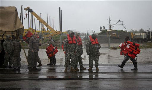 Guardsmen distribute life vests near Braithwaite, La., as they prepare to help flood victims from Plaquemines Parish, a rural area outside New Orleans that was flooded during Hurricane Isaac on Wednesday, Aug. 29, 2012.   <span class=meta>(AP Photo&#47; Erik Schelzig)</span>