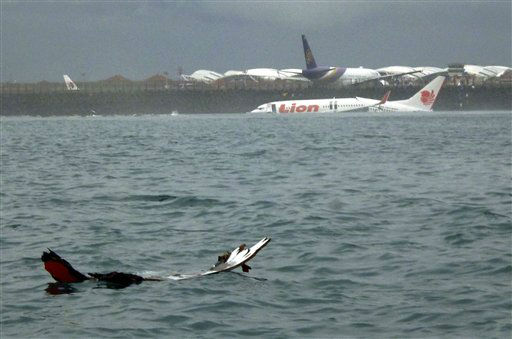 "<div class=""meta image-caption""><div class=""origin-logo origin-image ""><span></span></div><span class=""caption-text"">The wreckage a crashed Lion Air plane sits on the water near the airport in Bali, Indonesia on Saturday, April 13, 2013. The plane carrying more than 100 passengers and crew overshot a runway on the Indonesian resort island of Bali on Saturday and crashed into the sea, injuring nearly two dozen people, officials said.   (AP Photo/ Uncredited)</span></div>"