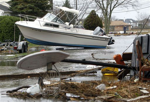As flood waters recede, a boat and other wreckage litter a street in the aftermath of superstorm Sandy, Tuesday, Oct. 30, 2012, in Massapequa, N.Y. &#40;AP Photo&#47;Jason DeCrow&#41; <span class=meta>(AP Photo&#47; Jason DeCrow)</span>