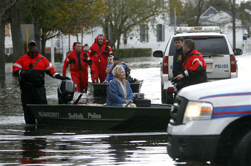 Elaine Belviso, 72, is rescued from her flooded home by Suffolk County police after being trapped there overnight by superstorm Sandy, Tuesday, Oct. 30, 2012, in Babylon, N.Y. Sandy arrived along the East Coast and morphed into a huge and problematic system, putting more than 7.5 million homes and businesses in the dark and causing a number of deaths.   <span class=meta>(AP Photo&#47; Jason DeCrow)</span>