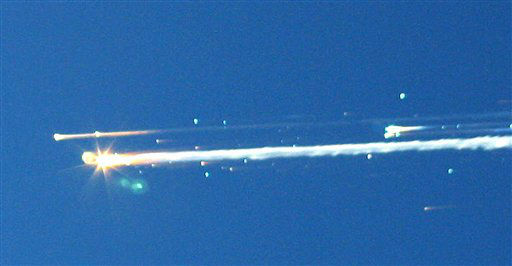 FILE - In this Feb. 1, 2003 file photo, debris from the space shuttle Columbia streaks across the sky over Tyler, Texas. The Columbia broke apart in flames 200,000 feet over Texas on Saturday, killing all seven astronauts just minutes before they were to glide to a landing in Florida.  Ten years later, reminders of Columbia are everywhere, including up in the sky.  Everything from asteroids, lunar craters and Martian hills, to schools, parks, streets and even an airport &#40;Rick Husband Amarillo International Airport&#41; bear the Columbia astronauts&#39; names. Two years ago, a museum opened in Hemphill, Texas, where much of the Columbia wreckage rained down, dedicated to &#34;remembering Columbia.&#34;  About 84,000 pounds of that wreckage, representing 40 percent of NASA&#39;s oldest space shuttle, are stored at Kennedy and loaned for engineering research.  &#40;AP Photo&#47;Scott Lieberman&#41;  MANDATORY CREDIT <span class=meta>(AP Photo&#47; Scott Lieberman)</span>