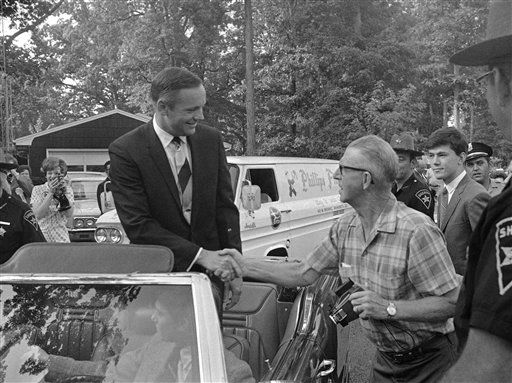 Astronaut Neil Armstrong, sitting atop a convertible, greets a hometown folk as he arrives at the Wapakoneta High School to start a round of homecoming festivities on Sept. 6, 1969. Armstrong, the first man to walk on the moon, was born in a farm house just outside Wapakoneta, Ohio.   <span class=meta>(AP Photo&#47; Anonymous)</span>