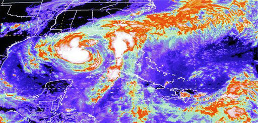 "<div class=""meta ""><span class=""caption-text "">An infrared satelite image of Tropical Storm Isaac is shown on a screen at the National Hurricane Center in Miami, Monday, Aug. 2, 2012. As of 2:00 PM  EDT Tropical Storm Isaac's location is 26.1 N 85.9W, about 255 miles SSW of Apalachicola, Fla., about 280 miles SE of the mouth of the Mississippi River, maximum sustained winds of 65 mph,  present movement NW or 305 degrees at 14 mph, minimum central pressure 984 MB.   (AP Photo/ Alan Diaz)</span></div>"