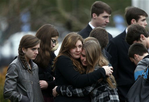 Mourners comfort one another as they leave a funeral service for 6-year-old Noah Pozner, Monday, Dec. 17, 2012, in Fairfield, Conn.  Pozner was killed when a gunman walked into Sandy Hook Elementary School in Newtown Friday and opened fire, killing 26 people, including 20 children. &#40;AP Photo&#47;Jason DeCrow&#41; <span class=meta>(AP Photo&#47; Jason DeCrow)</span>