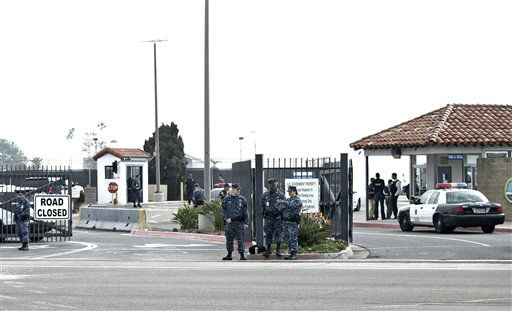 Military police stand guard outside Naval Base Point Loma in San Diego as San Diego police officers and federal agents search for former Los Angeles officer Christopher Dorner who police believe is responsible for three murders Thursday Feb. 7, 2013.  Thousands of police officers throughout Southern California and Nevada searched for Dorner,  who was angry over his firing and began a deadly shooting rampage that he warned in an online posting would target those on the force who wronged him. <span class=meta>(AP Photo&#47; Lenny Ignelzi)</span>