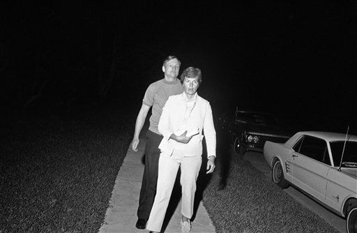 Neil Armstrong Apollo 11 commander and first man to set foot on the moon, accompanied by his wife, Jan, walk toward the home of Astronaut Fred W. Haise in Houston on April 15, 1970 to visit the family during the troubled flight of Apollo 13 at night.   <span class=meta>(AP Photo&#47; JC)</span>