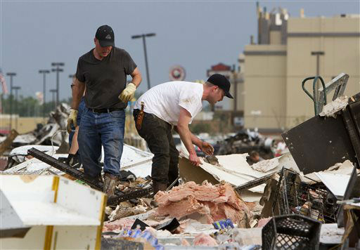 "<div class=""meta ""><span class=""caption-text "">People search the debris near Telephone Road and SW 4th Street in Moore, Okla. after a tornado on Monday, May 20, 2013.  (AP Photo/ Alonzo Adams)</span></div>"