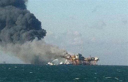 In this image released by a oil field worker and obtained by the Associated Press, a fire burns on a Gulf oil platform Friday, Nov. 16, 2012, after an explosion on the rig, in the Gulf of Mexico off the Louisiana coast. An explosion and fire ripped through a Gulf oil platform Friday as workers used a cutting torch, sending at least four people to a hospital with burns and leaving two missing in waters off Louisiana. &#40;AP Photo&#41; <span class=meta>(AP Photo&#47; Uncredited)</span>
