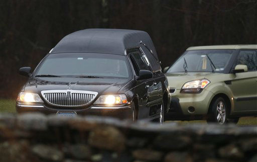 A hearse arrives at B&#39;nai Israel Cemetery with the body of Noah Pozner, a six-year-old killed in an elementary school shooting, during funeral services, Monday, Dec. 17, 2012, in Monroe, Conn. Authorities say gunman Adam Lanza killed his mother at their home on Friday and then opened fire inside the Sandy Hook Elementary School in Newtown, killing 26 people, including 20 children, before taking his own life. &#40;AP Photo&#47;Julio Cortez&#41; <span class=meta>(AP Photo&#47; Julio Cortez)</span>