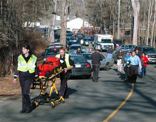 In this photo provided by the Newtown Bee, paramedics push stretchers toward Sandy Hook Elementary School in Newtown, Conn., where authorities say a gunman opened fire, killing 26 people, including 20 children, Friday, Dec. 14, 2012. &#40;AP Photo&#47;Newtown Bee, Shannon Hicks&#41;   <span class=meta>(AP Photo&#47; Shannon Hicks)</span>