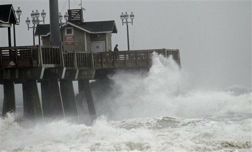 Large waves generated by Hurricane Sandy crash into Jeanette&#39;s Pier in Nags Head, N.C., Saturday, Oct. 27, 2012 as the storm moves up the east coast. Hurricane Sandy, upgraded again Saturday just hours after forecasters said it had weakened to a tropical storm, was barreling north from the Caribbean and was expected to make landfall early Tuesday near the Delaware coast, then hit two winter weather systems as it moves inland, creating a hybrid monster storm. &#40;AP Photo&#47;Gerry Broome&#41; <span class=meta>(AP Photo&#47; Gerry Broome)</span>