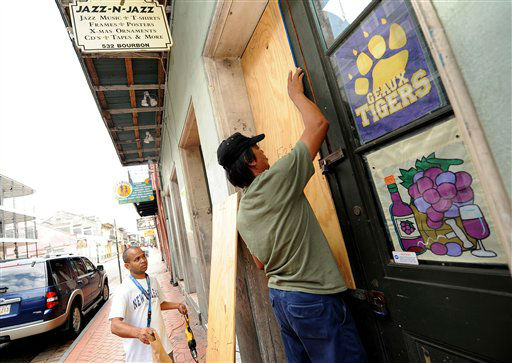 From left, Dayea Maya and Roberto Melendez board up their business on Bourbon Street as Isaac heads toward New Orleans, Tuesday, Aug. 28, 2012. The U.S. National Hurricane Center in Miami said Isaac became a Category 1 hurricane Tuesday with winds of 75 mph. It could get stronger by the time it&#39;s expected to reach the swampy coast of southeast Louisiana.    <span class=meta>(AP Photo&#47; CHERYL GERBER)</span>